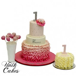 1st-birthday-cake-and-cake-pops-with-ombre-ruffles
