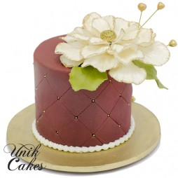 purple-cake-with-flower-and-gold-accents